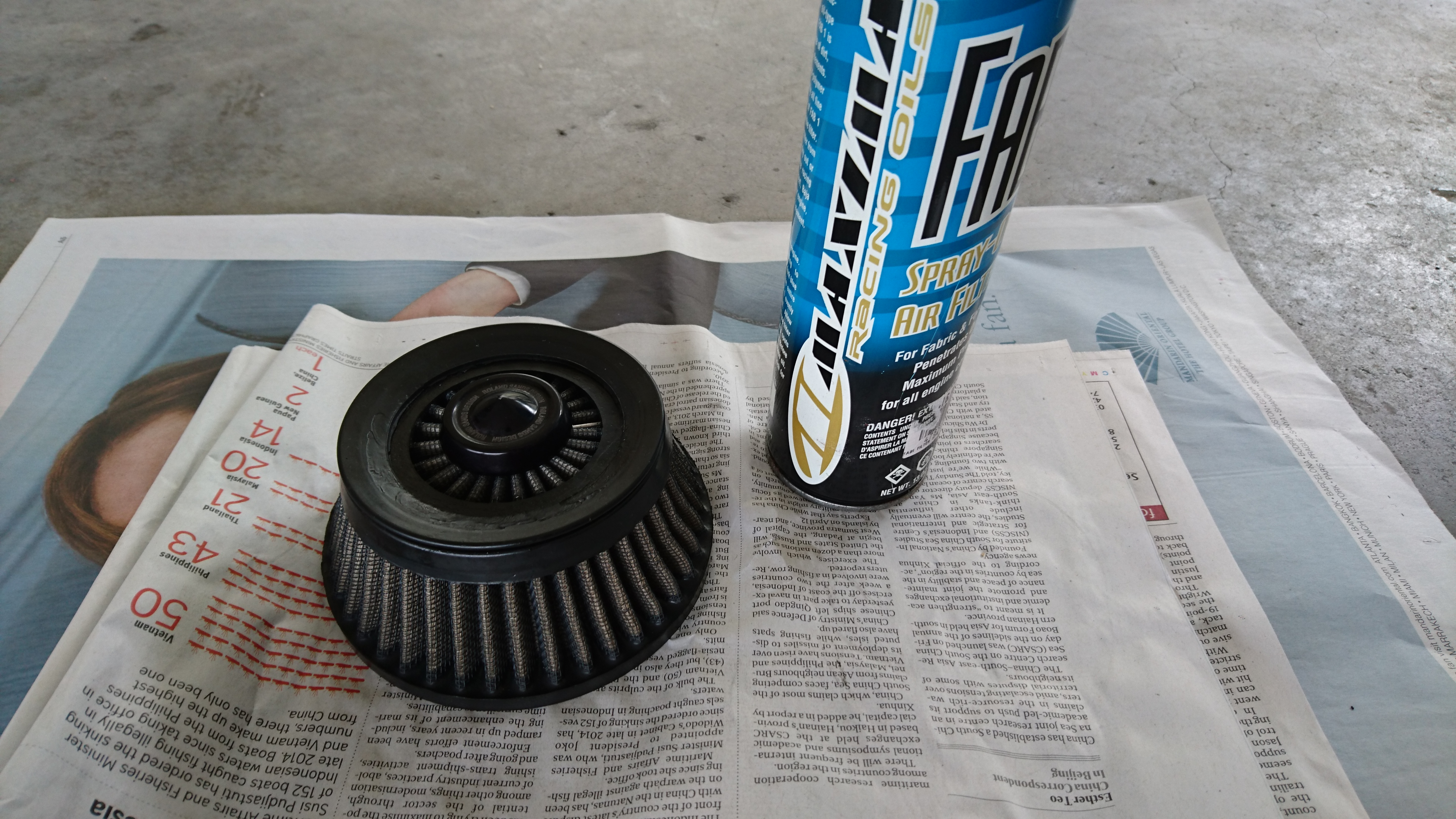 Spraying Maxima Air Filter Oil