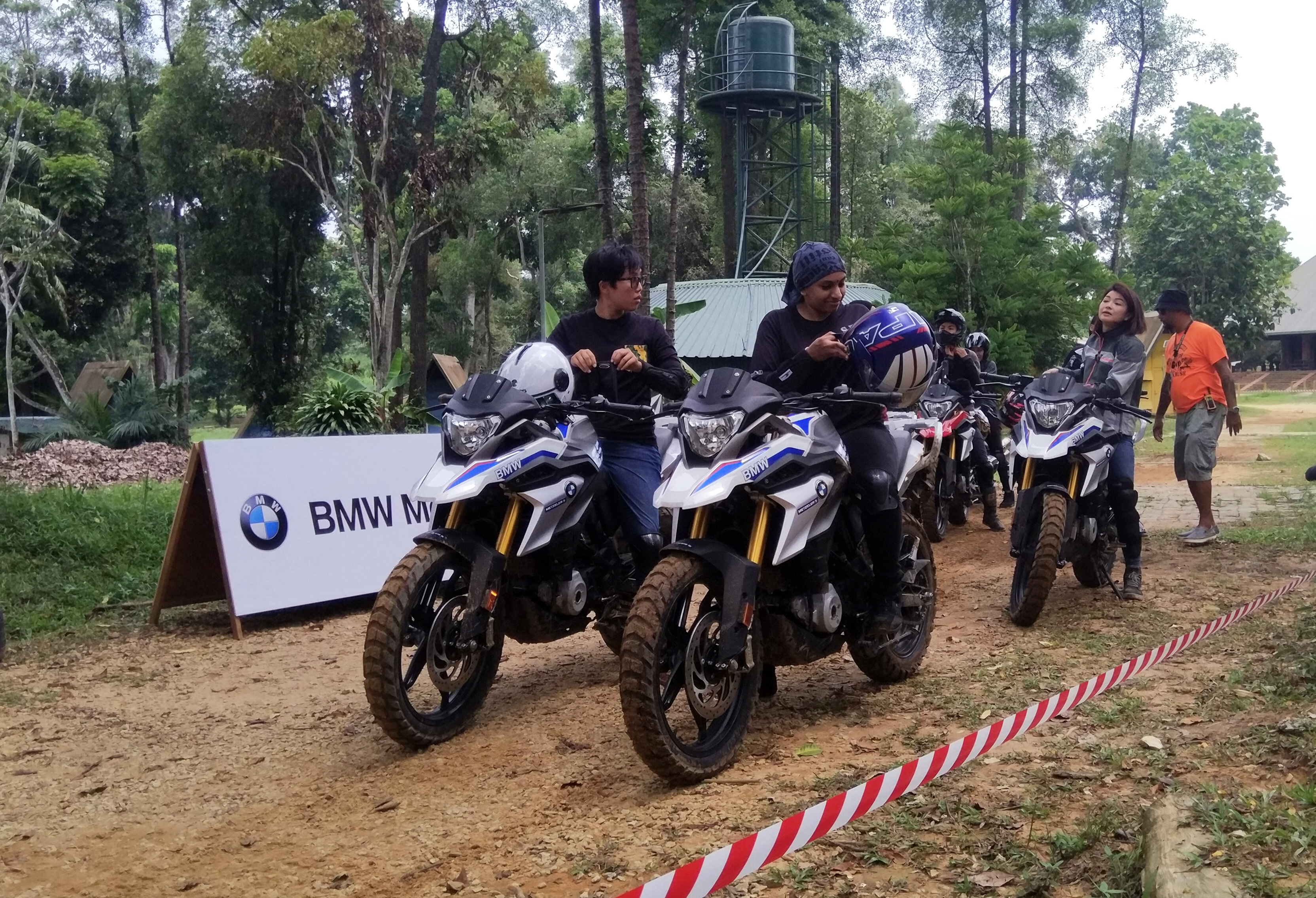 Riders preparing to move off on their BMW G310GS